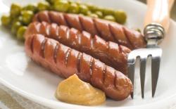 Saucisses de porc et petits pois