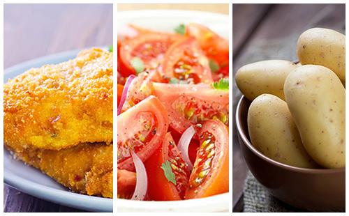 Poulet pané, pommes de terre et salade de tomates